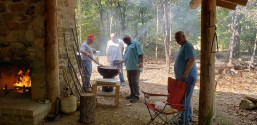 Men grilling hamburgers and hot dogs